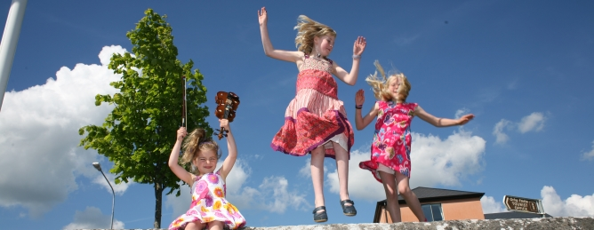 three Leitrim children jumping