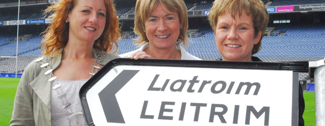 three ladies with Leitrim sign